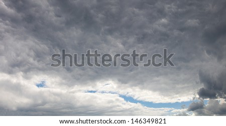 big grey sky and clouds before storm and lighting - stock photo