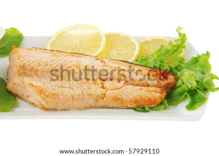 big grilled salmon steak over white plate - stock photo
