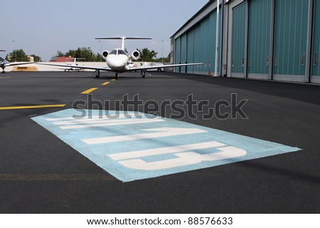 Big ground sign on the aircraft stand position - stock photo