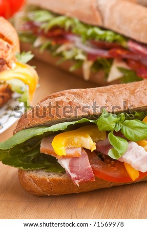 big group of sandwiches on a table - stock photo