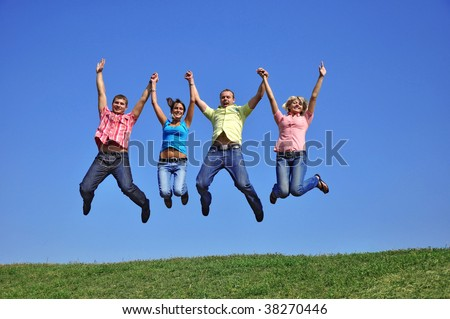Big group of young jumping people with hands up - stock photo