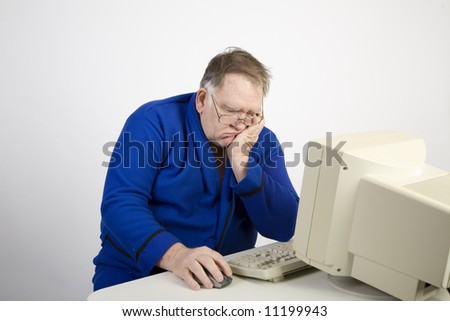 Big Guy catching a nap at the computer - stock photo