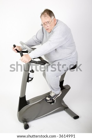 Big Guy working on the pounds on a bike - stock photo