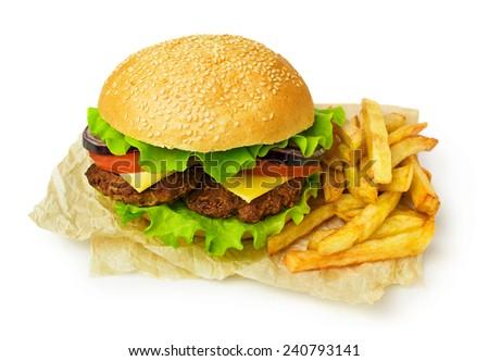 Big hamburger and french fries isolated on white - stock photo