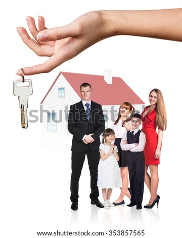 Big hand give keys to young family isolated on white background - stock photo