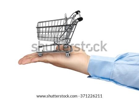 Big hand holding empty shopping cart isolated - stock photo
