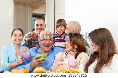 Big happy family communicate over tea - stock photo