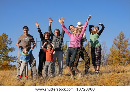 Big happy family in autumn park 2 - stock photo