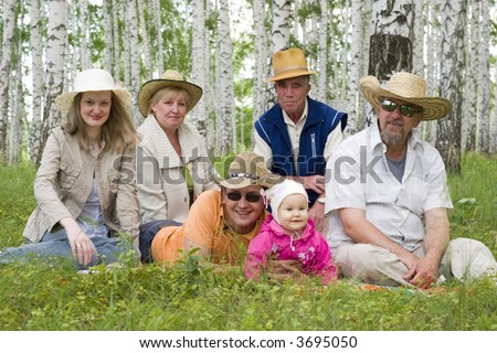 big happy family - mother, grandmother, father, daughter, grandfather, great-grandfather at the forest - stock photo