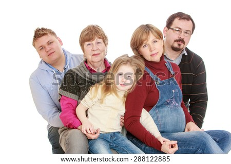 Big happy family of 5 people grandmother, a pregnant mother, father, brother and younger sister-isolated on white background - stock photo