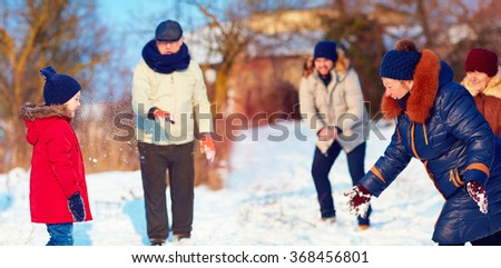 big happy family playing snowballs on beautiful winter day - stock photo