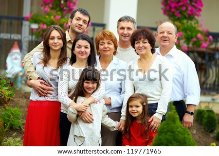 big happy family portrait, at home yard - stock photo