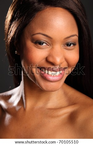 Big happy smile on beautiful black woman - stock photo