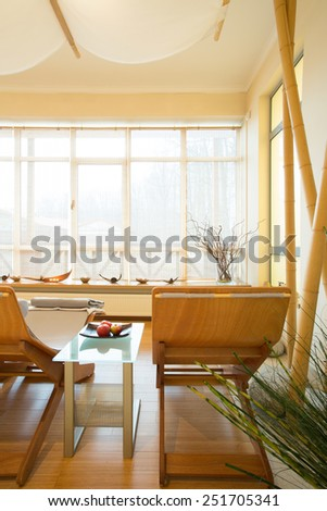 Big health resort with suitable loungers and wooden floor - stock photo