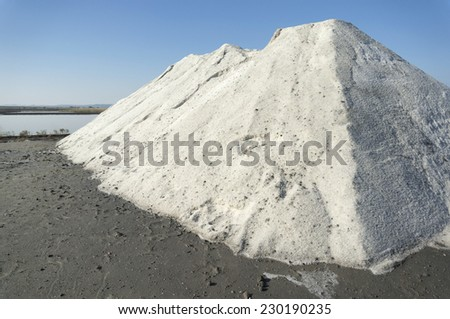 Big heap of sea salt extracted through natural evaporation at the salt lake near Burgas, Bulgaria - stock photo