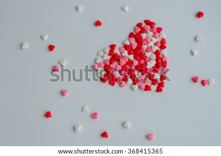 Big heart with little red, pink and white hearts on light background. Empty space for text. Valentines Day background. Valentine's Day theme. Romantic love background.  - stock photo