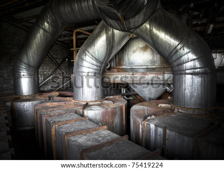 Big heavy tubes at an abandoned sugar factory - stock photo