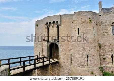 big historic castle by sea - stock photo