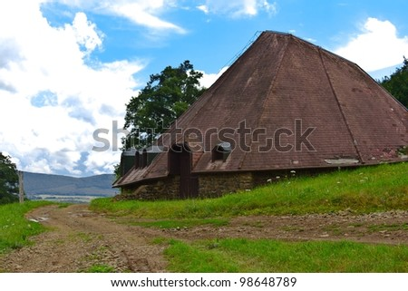 Big house in the middle of the field near Holloko, Hungary. - stock photo