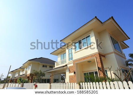 Big house modern style with sunshine and blue sky background - stock photo