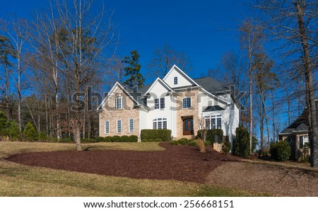 Big house on a hillside - stock photo