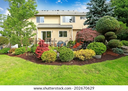Big house with backyard tropical landscape design - stock photo