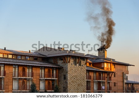 big house with balconies on winter sky background - stock photo
