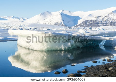 Big iceberg in sun light. Jokulsarlon glacier lake lagoon. Vatnajokull National Park. Iceland.
