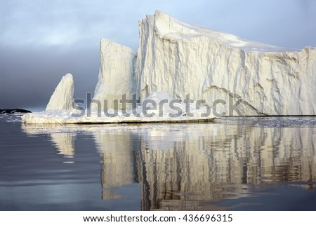 Big iceberg on the arctic ocean at Ilulissat fiord, Greenland. There are many icebergs are melting day by day. An area, so beautiful and unique, that UNESCO has accepted it on The World Heritage List. - stock photo