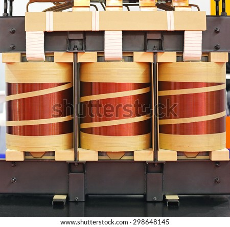 Big Industrial Electric Transformer Device With Copper Wire Coils - stock photo