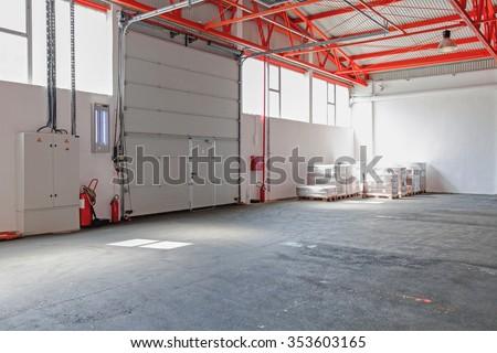Big Industrial Garage Door at Warehouse Entrance - stock photo