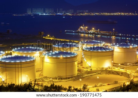 Big Industrial oil tanks in a refinery at night - stock photo