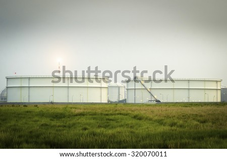 Big Industrial oil tanks - Natural Gas storage tanks - Oil Refinery factory at twilight , petrochemical plant , Petroleum , Chemical Industry - stock photo