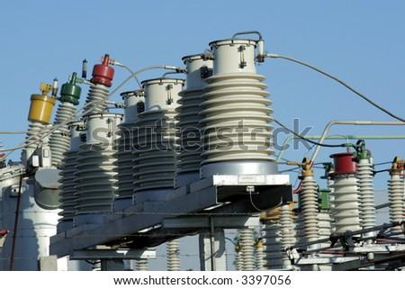 Big insulators on the high-voltage substation - stock photo
