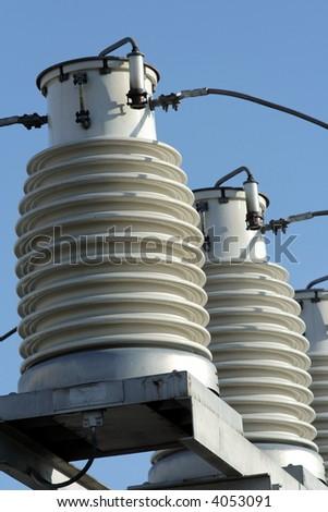 big insulators on the high-voltage substation 2 - stock photo