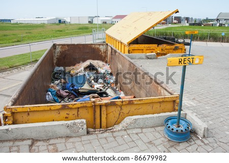 Big iron dumpsters at a refuse dump - stock photo
