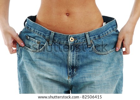 big jeans on small woman - stock photo