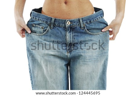 big jeans on small woman isolated - stock photo