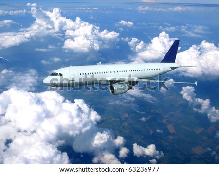 Big jet airplane above clouds - stock photo