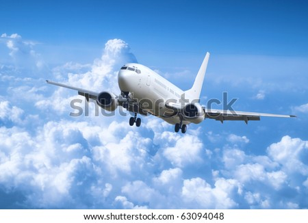 Big jet plane above clouds - stock photo