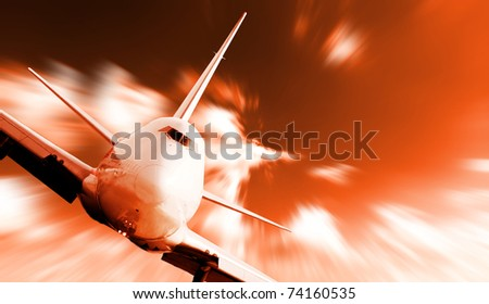 Big jet plane flying on blur motion sky background - stock photo