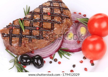 Big juicy grilled steak with greens. - stock photo