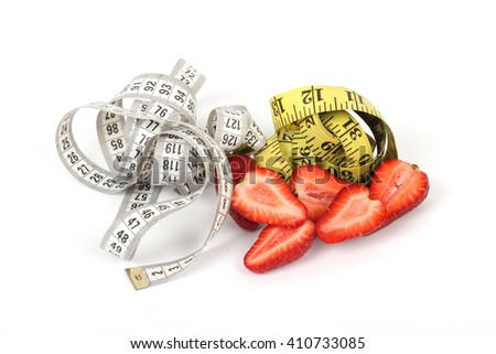 big juicy red ripe strawberries and measure tape isolated on white - stock photo