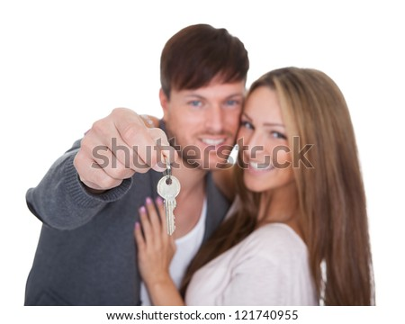 Big key for new condominium held by boyfriend. - stock photo