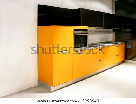 Big kitchen with yellow counter furniture angle