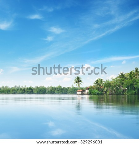 Big lake and beautiful sky - stock photo