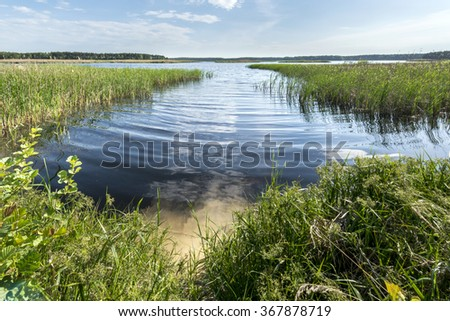 Big lake in the forest in Eastern Poland - stock photo