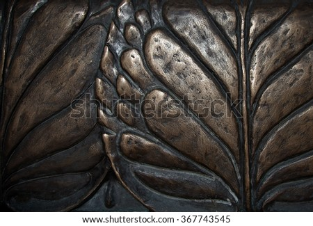 Big leaves close-up macro dark bronze metal relief background. Vintage water lily sculpture foliage art - stock photo