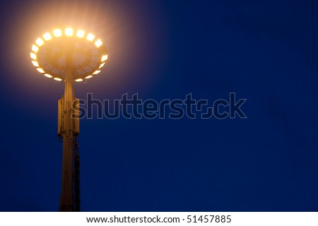 Big light pole against the blue sky at night - stock photo
