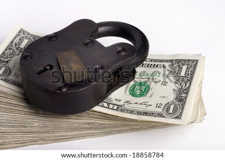 big lock on stack of money - stock photo